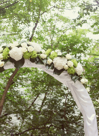 Wedding Arch with flowers on the grass photo