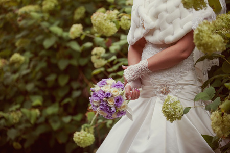 beautiful bride: white wedding bouquet  in the hands of the bride Stock Photo