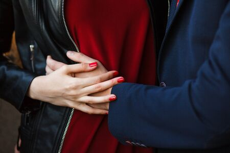 Close up view of couple holding hands, loving wife supporting or comforting husband ready to help expressing sympathy, encouraging and understanding in marriage relationships, reconciliation concept