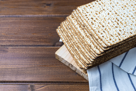 Stack of matzah or matza , Jewish traditional passover celebration on a wooden table with copy space