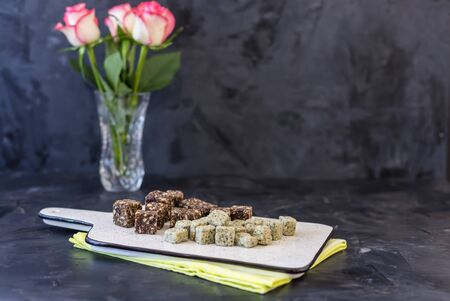 Healthy organic energy bites with hemp and blueberries . Vegan, vegetarian, raw snack on a ceramic plate on a wooden table  with copy space Stock Photo