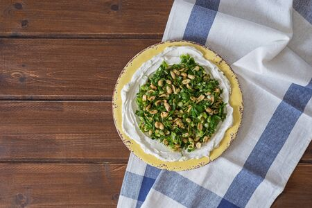 homemade labneh or labaneh middle eastern soft white goats milk cheese with fresh Taboule salad ,  served at traditional dinner over rustic table .top view flat lay with copy space