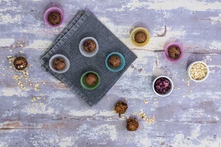 Oatmeal balls , Oats dates and cranberries energy balls, selective focus , top view , flatlay Reklamní fotografie