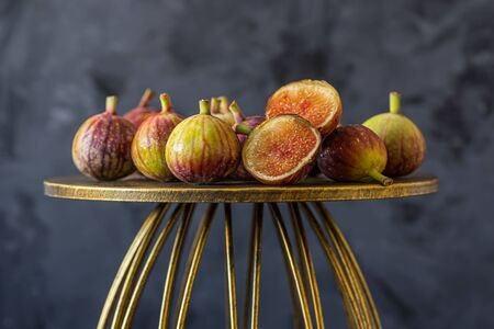 Fresh ripe figs on black background. Healthy mediterranean fruit. Close up