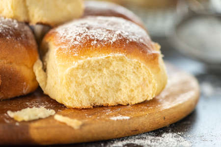 Sweet bread rolls with powdered sugar on top, close up