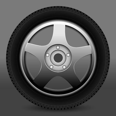 Car wheel on a grey background.