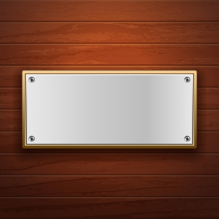 Metal plate on wooden surface