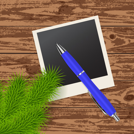 blue pen: twig tree, photo frame and blue pen on the wooden background