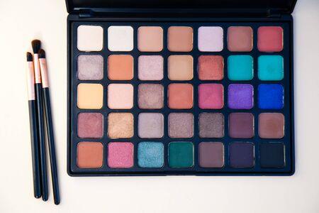 Palette of colorful make up eye shadow and brush. Reklamní fotografie