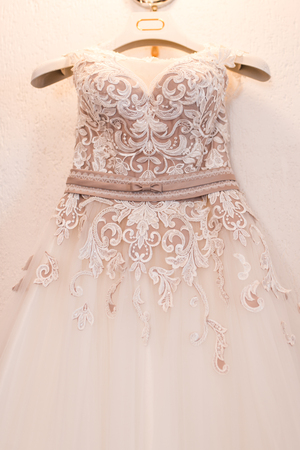 Image of the wedding dress on a hanger Stock Photo