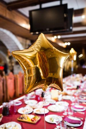 Shining golden balloons in the shape of stars. Decor
