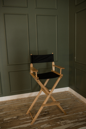 high modern chair on a green background high director chair stock