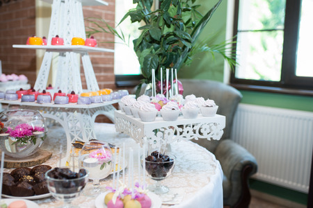 Candy bar. A lot of sweets at the wedding.