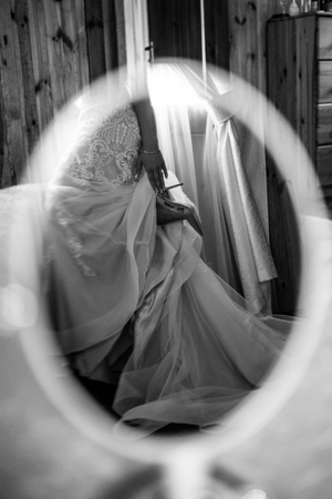 Reflection of the brides shoes in the mirror. Black and white photo.