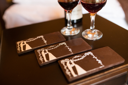 Three chocolate bars with the image of the bride and groom. Chocolate candy, tiles.