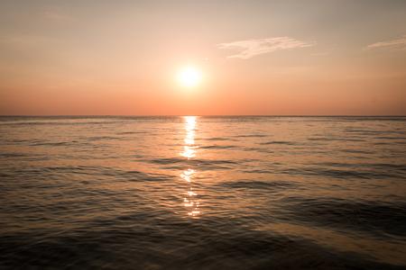 Golden sunset view of seaside