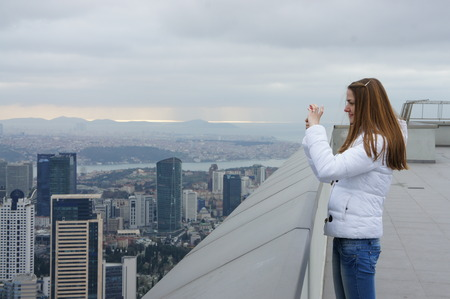 Girl in a white jacket with long hair. Overcast