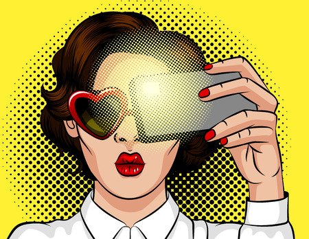 Color vector illustration in pop art style. Brunette girl with heart-shaped sunglasses. Beautiful lady with red lips posing for photo over yellow background. Girl makes selfie on smartphone.