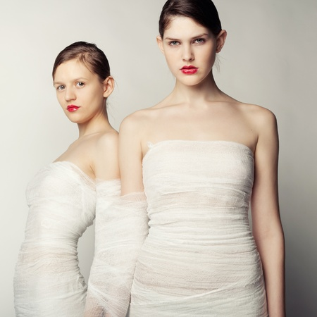 Two young women in bandages photo