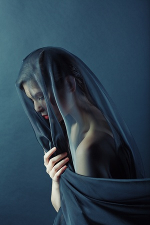 portrait of a young girl in a veil photo