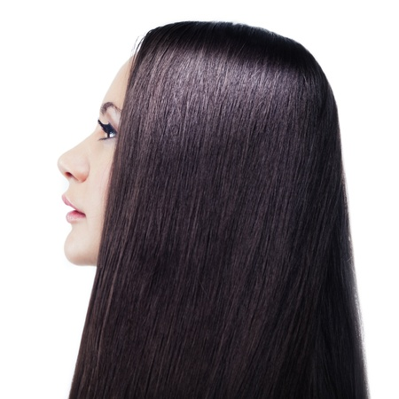 Isolated portrait of a young long-haired brunette in a profile photo