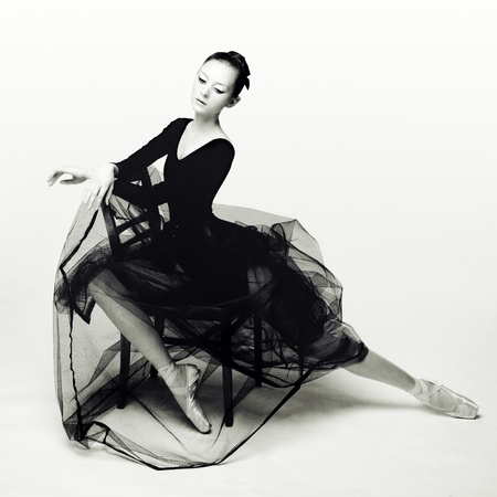 Studio photo of a young dancer in black. photo