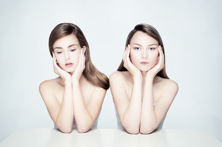 Studio photo of two young women in pastel colors. photo