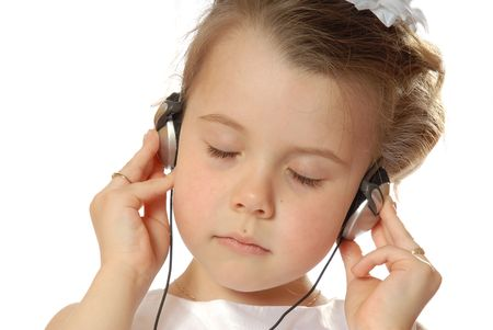 music therapy: girl listening to music Stock Photo