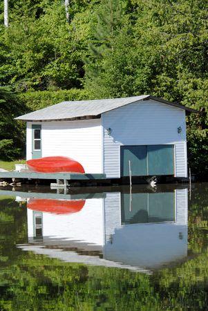 boathouse: boathouse on a lake vertical