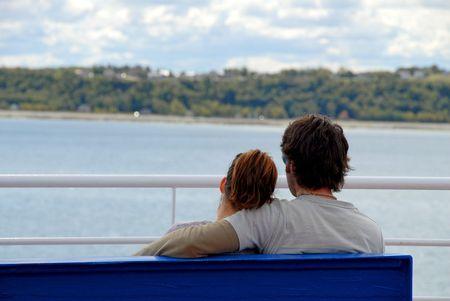 pair on a bench Фото со стока