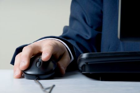 man holding mouse by computer Stock Photo - 545412