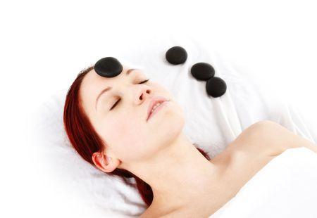 woman getting a hot stone massage treatment photo