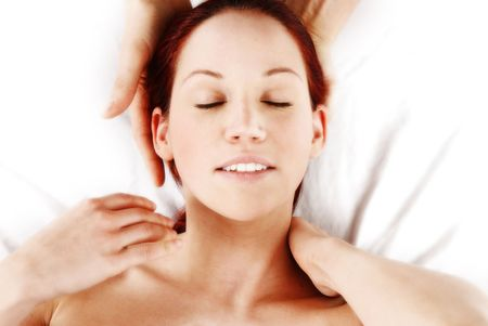woman getting a neck and shoulder massage photo
