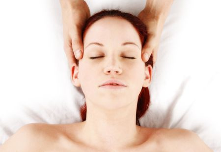 woman getting head and neck massage by therapist photo