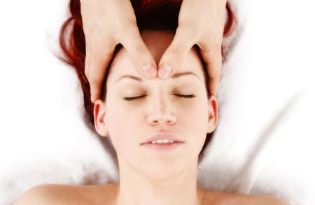 woman getting a head massage by therapist photo