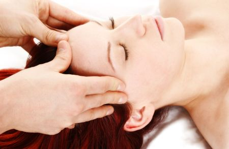 woman getting a head and shoulder massage photo