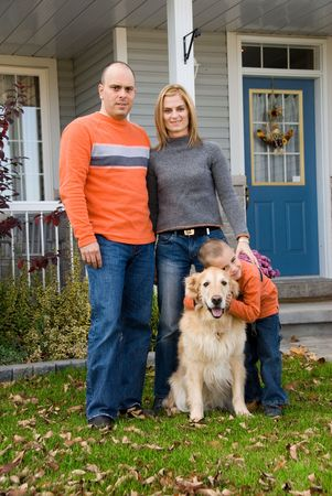 mother, father, son and dog in front of house Stock Photo - 621671
