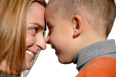 family tickle: mother and son touching heads and smiling Stock Photo