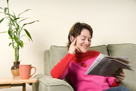 smiling woman reading the newspaper with pen Stock Photo - 621655