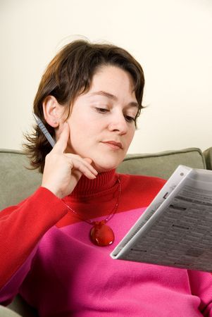 cute woman reading the classifieds in the newspaper Stock Photo - 621656