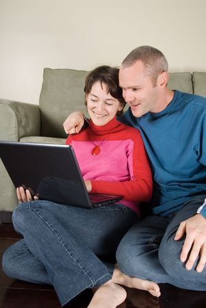 couple looking at emails on a black laptop photo