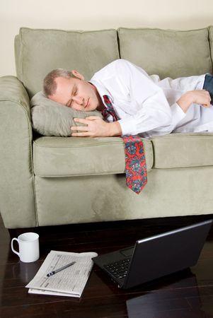 tired businessman: tired businessman that felt asleep white working
