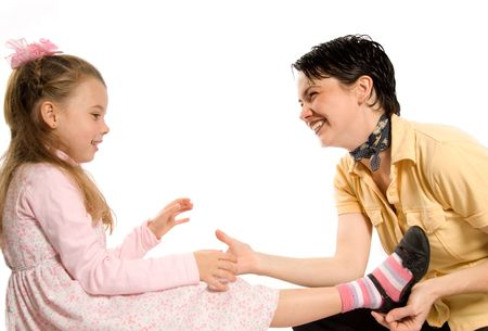 family tickle: mom and daughter sharing a moment on white Stock Photo