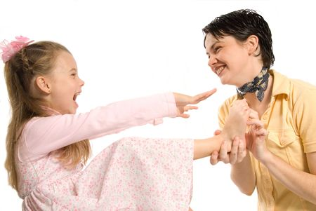 mom and daughter laughing whie tickling feet Stock Photo - 621539