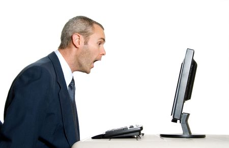 baffled: surprised man in blue suit in front of computer
