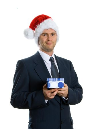 Santa man in blue suit giving gift box photo