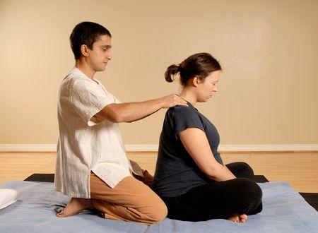 Thai massage of the neck on matt Stock Photo
