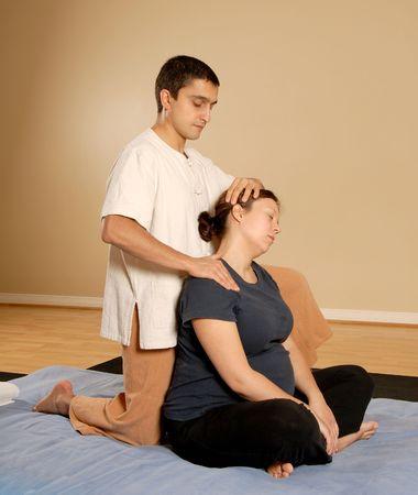 therapist stretching clients neck in massage thai