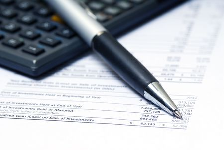 accountant calculating numbers with pen in macro Stock Photo - 652832