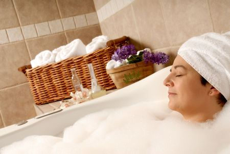 woman getting a spa bath to relax with bubbles Stock Photo - 693749
